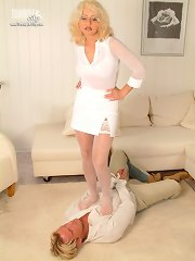 Mistress in pantyhose tramples man.