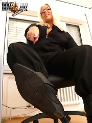 Office mistress with dirty boots
