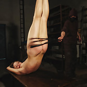 Lola was hanged by her legs increased by whipped hard.