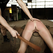 Brutal paddling and whipping on a rusty barrel with Amy.