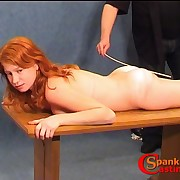 Young ginger pet has her bootie oiled and caned