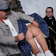 A immoral chick was spanked on the knee