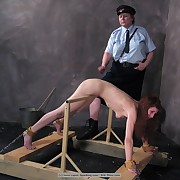 The slut has her slave caned in the prison
