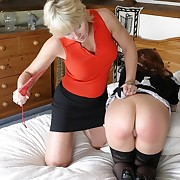 Brutish mistress spanks her lesbian wench