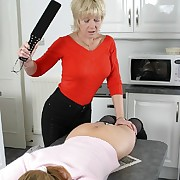 Female spanking of the kitchen