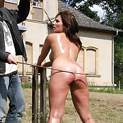 Branchs cutting pain on brunettes oiled sweet round uncovered ass in bondage