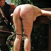 Blonde vacant beauty gets bitter beaten by stinging whip lashes alfresco