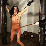 Hot slavegirl Alex drives nutty under lashes of wet cat while she is hanged up in chains