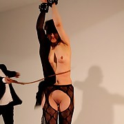 Sunspended at hammer away end of one's tether her wrists hammer away girl receives hammer away bullwhipping
