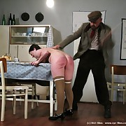 A obese girl receiving the caning of her leap