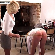 Stocking clock girl spreads her legs with an increment of ass cheeks for a dehydration caning - bottomless gulf stripes