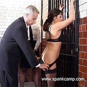 Beautiful cooky in stockings spanked on all fours in cell block beating