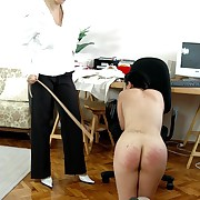 Naked young beauty leaning over burnish apply bureau together with caned hard on her upturned buttocks