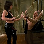 Mistress Penny ties a slaveboy and fucked him apart from a strapon