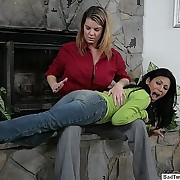 Exotic girl OTK spanked by the fireplace