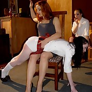 Two charming juvenile schoolgirls spanked and paddled on their bared asses