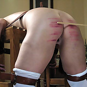 Caning of locked girl