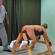 Girl straddles wooden device and gets paddled viciously