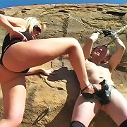 Shayne Ryder chains her bondman outside and abuses his cock