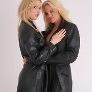 Fran and Lou are dressed in beautiful leather trench coats and not a lot else.