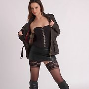 This dark brown acquires turned on when she wears her boots and shows off her pussy