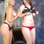 Two lesbian babes play costume up with some leather lingerie