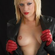 Axa is wearing a gorgeous leather outfit including boots and gloves