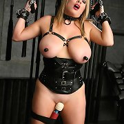 G-cupped sexy blonde Maggie Green pleasures herself in the dungeon, with dildos, vibrators, kinky thraldom and leather