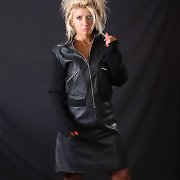 Horny Nicole is bare below all this pretty leather