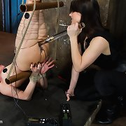 Strung upside down, legs wrapped with copper, a-hole stuffed with an electric plug & drilled with a metal dick