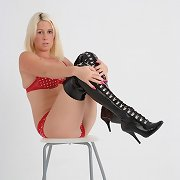 These red polka dot pants come right off this golden-haired leaving her in just leather boots
