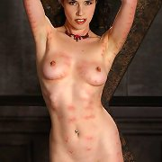 Fetish model Anastasia Pierce receives clamped with clothespins all over her naked body, enjoying masochistic ache everywhere