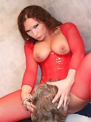 Mistress in red in facesitting action