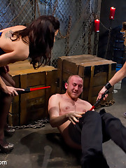 Two latex dommes punish and smother a man
