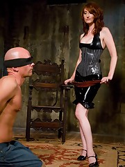 Mistress Kendra worn in latex is beating and fucking a slaveboy