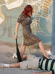 Redhead mistress tramples a bad boy