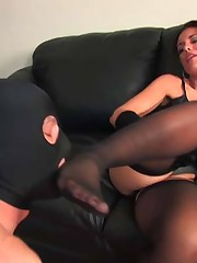 Haley condomizes her captive's cock before letting it near her mouth