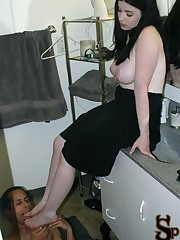 Sybil catches her foot slave trying to watch her topless in the bathroom putting makeup on.