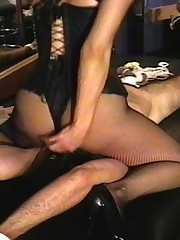 Hot brunette in leather abuses his cock and balls