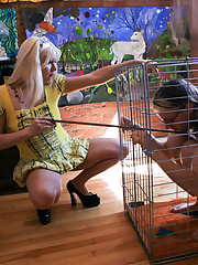 Randy is caged and leashed like a dog, and tormented