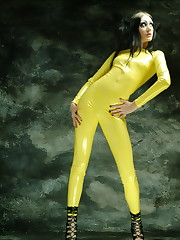 Fetish model in bright shiny yellow latex body suit.