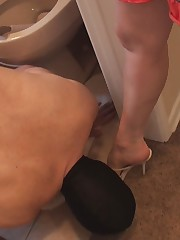 Poor slave cleaning toilet and his Mistress's shoes