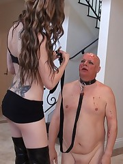 Tattooed Mistresses watching their slave licking the floor