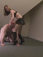 Torturing of slave's hands are by mistress's high hills.