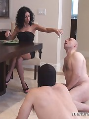 Ladies spit food into mouths of their obedient slaves