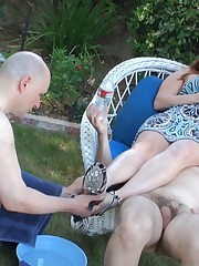 Two obedient slaves are at the disposal of sexy lady