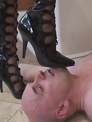 Slave suffering from mistress's feet on his face