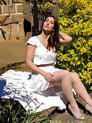 Mistress is posing in green garden