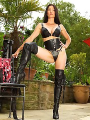 Miss Hybrid getting her leather thighboots wet