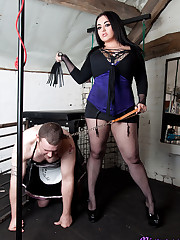 Mistress Jemstone stands on poor Adys balls and whip his ass